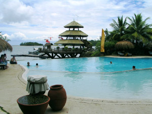 Photo of the Parola Wharf and infinity pool at Pearl Farm Beach Resort.