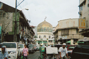 Ground-level photo of the Golden Mosque of Quiapo looking south along Gunao St.