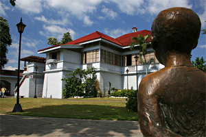 Photo of the Rizal Shrine, with a statue of the boy Rizal in the foreground.