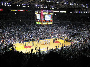 Photo of the interior of the Araneta Coliseum at the conclusion of a basketball game.