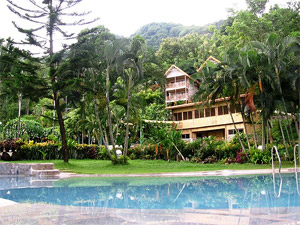 Pool-side photo of the Gardens of Malasag showing some of the amenities.