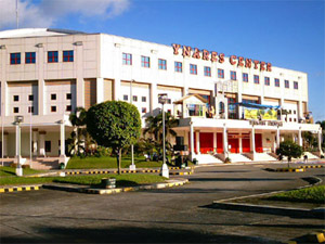 Photo of the Ynares Center facade from the parking lot.