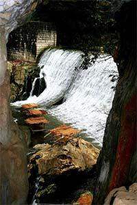 Side shot of the Wawa Dam waterfall.