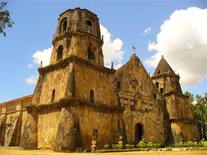 Photo of the impressive facade of the Miag-ao Church.