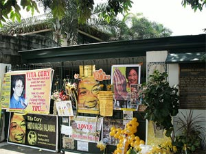 Posters and banners put up at the gate of the Aquino residence